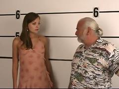 arrested youthful brunette hair undresses for old