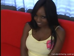 large titty black gal gives handjob
